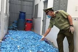 Thu giữ 21 tấn găng tay, quần áo chống dịch đã qua sử dụng